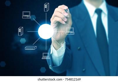 Man sketching computer network