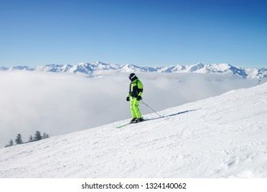 Man Skier in Zillertal Arena ski resort in Zillertal in Tyrol. Mayrhofen, in Austria in winter in Alps. Person at Alpine mountains with snow. Downhill fun. Blue sky and white slopes at Zell am Ziller.