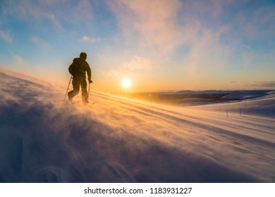 Man skiing in blizzard in Lapland Finland