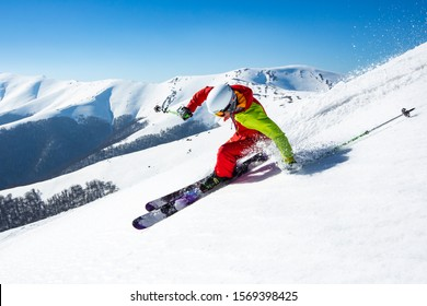 A man is skiing down the hill on the steep slope in Carpathians.
