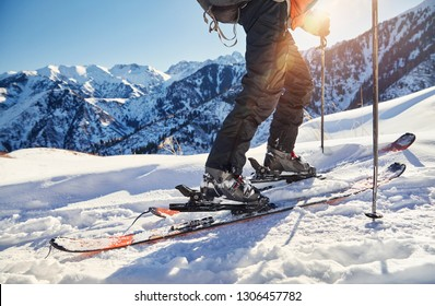 Man skiing on fresh powder snow at the mountains close up shot, low angle.