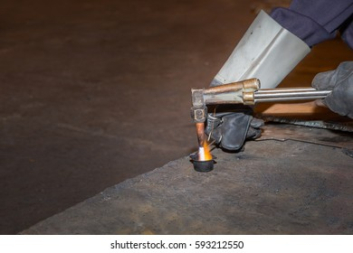 A man skilled working factory welder,cutting,grinding,drill