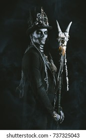 A man with a skull makeup dressed in a tail-coat and a top-hat. Baron Saturday.  Dia de los muertos. Day of The Dead. Halloween.