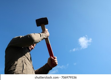 Man with a sledge hammer