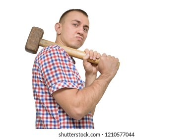 Man with a sledgehammer on a white background. Work concept. Isolate