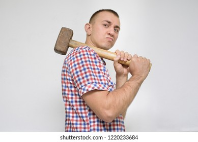 Man with a sledgehammer on a white background. Work concept