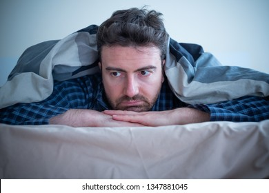 Man with sleep disorder lying in the bed