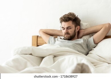 The man sleep on the bed in the morning. Today was a holiday so he woke up late.Relaxing enough to be healthy.