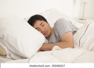 Man sleeping - Shutterstock ID 292450217
