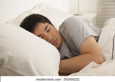 Man sleeping - Shutterstock ID 292450232