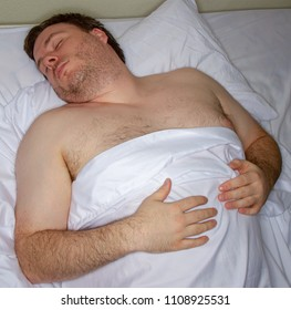 Man sleeping in bed after a long day