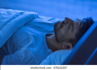 The man sleeping in the bed. night time