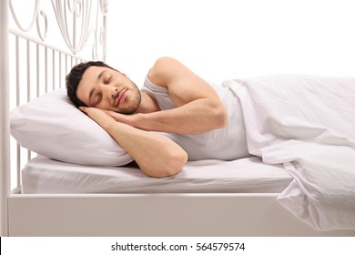 Man sleeping comfortably in bed isolated on white background