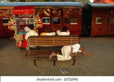 Man sleeping in front of a Train in India