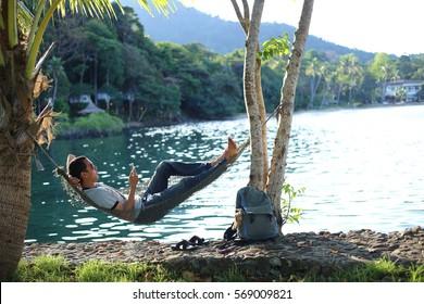 Man sleeping in a hammock at the beach