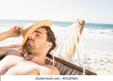 Man sleeping in hammock on the beach
