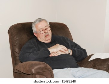 Man sleeping in his lounger chair