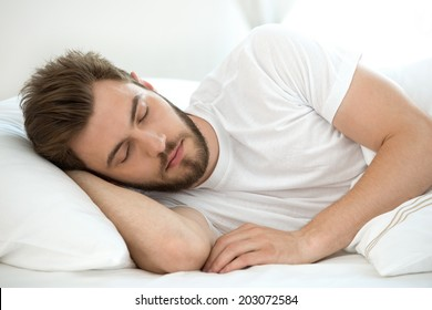 Man sleeping on white bad
