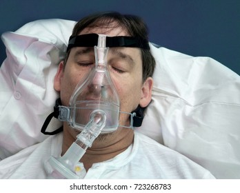 Man sleeping peacefully with cpap mask  on