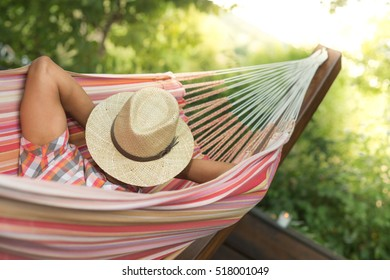 Man Sleeping and Relaxing With hat on face In Hammock, France