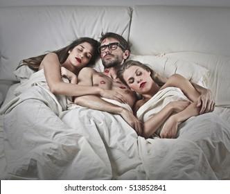 Man sleeping with two women