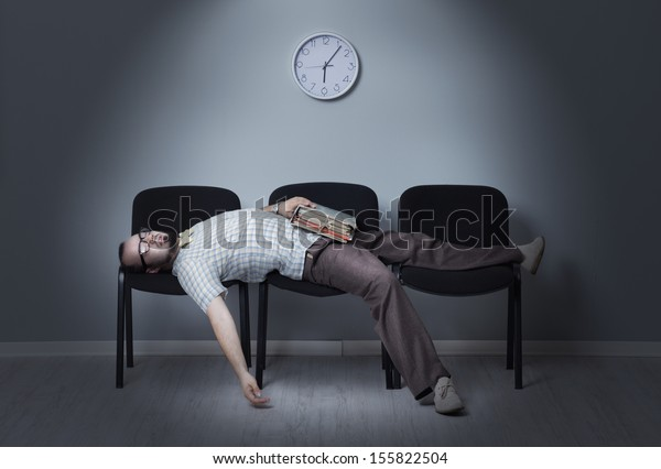 Man sleeps in a waiting room chairs
