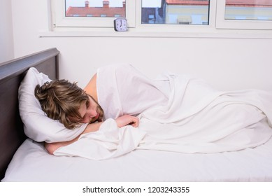 Man sleepy drowsy unshaven bearded face covered blanket having nap. Guy lay under white bedclothes. Man unshaven handsome relaxing bed. Power napping may help you get through day. Have nap relax.