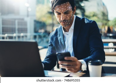 Man with smartphone using face ID recognition system