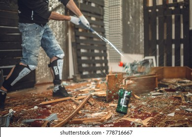 a man smashing the bottle with golf club