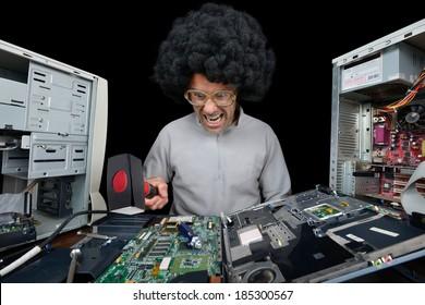 man smashing laptop with hammer