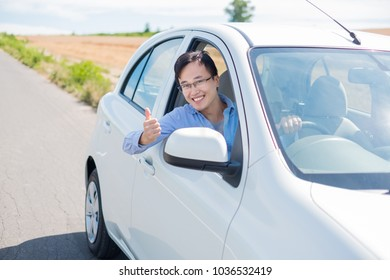 man smile happily and drive car in Furano