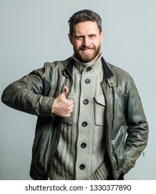 Man smile with thumbs up. Happy man wear leather jacket. Recommendation concept. Satisfied bearded guy. Excellent quality. Sincere recommendation. Highly recommend. Thumbs up symbol of recommendation.
