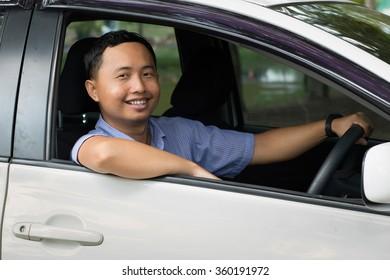 Man smiling Greet on car