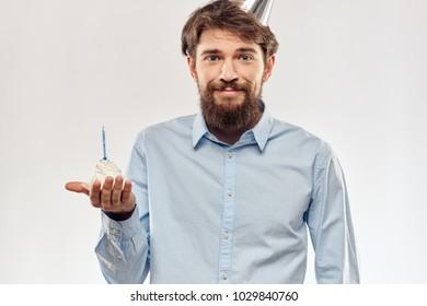 man smiling holding a cake, birthday