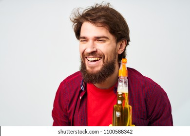 man smiling holding a cleanser