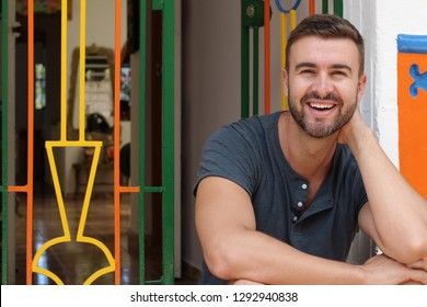 Man smiling at home entrance