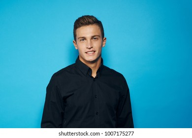 man smiling on a blue background