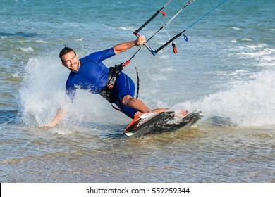 Man smiling practicing kitesurfing