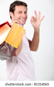 Man smiling with shopping bags