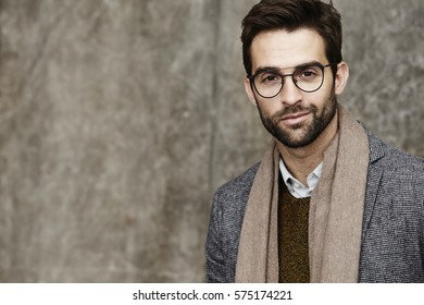Man smiling in spectacles, portrait