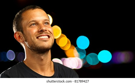 man smiling wearing casual clothes in the city