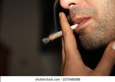 A man smokes cannabis weed