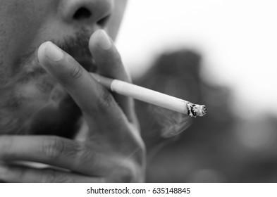 Man smokes a cigarette