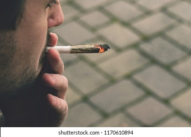Man smoking cannabis joint