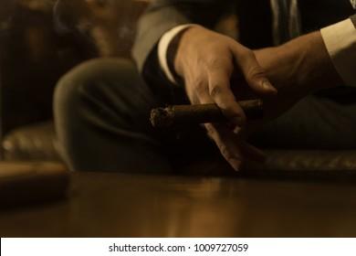 Man is smoking a cigar