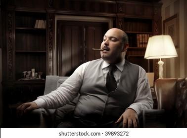 man smoking cigar in a luxury office
