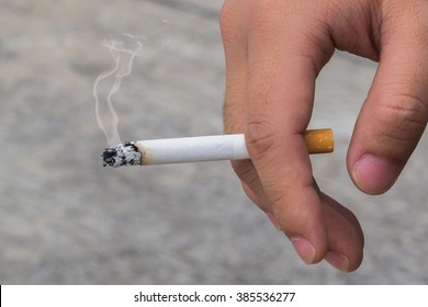man smoking a cigarette