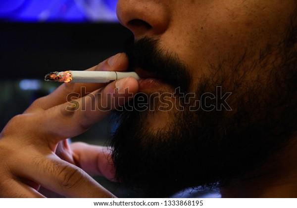 man-smoking-cigarette-addiction-treatmen