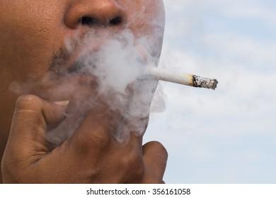 man smoking a cigarette close up