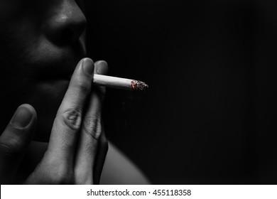 man smoking cigarette in monochrome